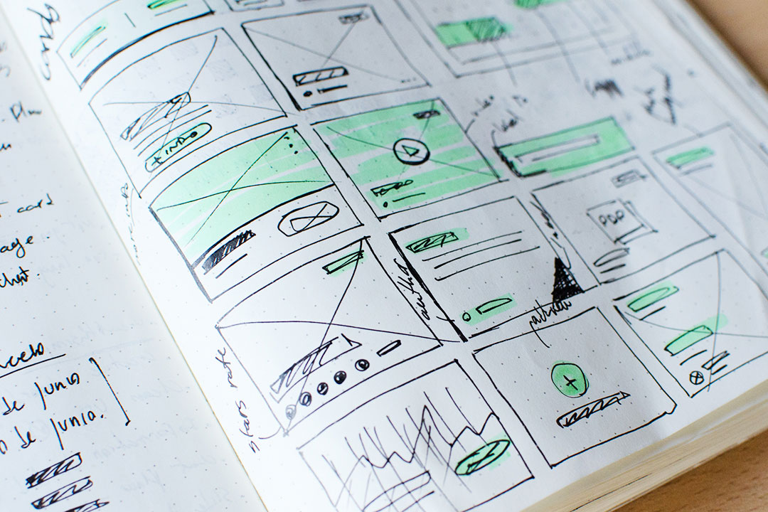 Handwritten wireframes in a notebook