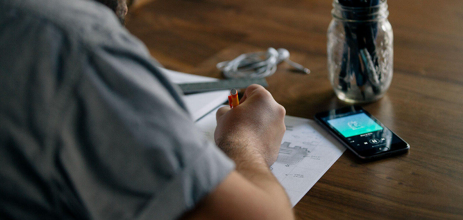 UX designer sketching wireframes for a new Drupal project